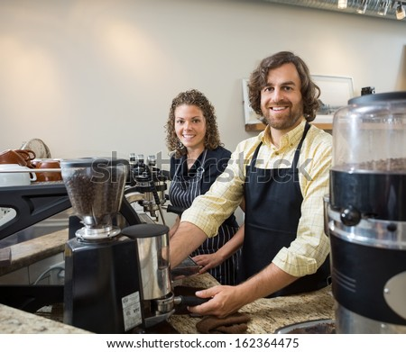 Portrait of happy colleagues working in coffeeshop - stock photo