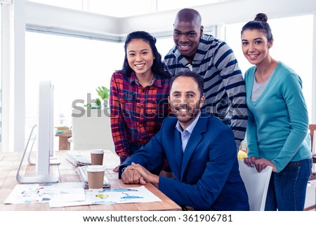 Portrait of happy confident business team in creative office - stock photo