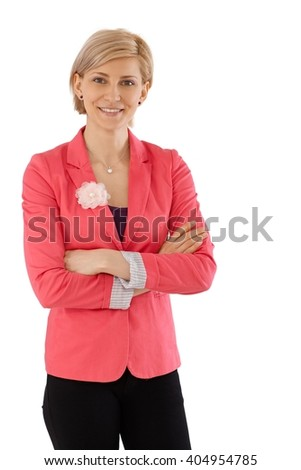 Portrait of happy confident businesswoman standing arms crossed over white background.
