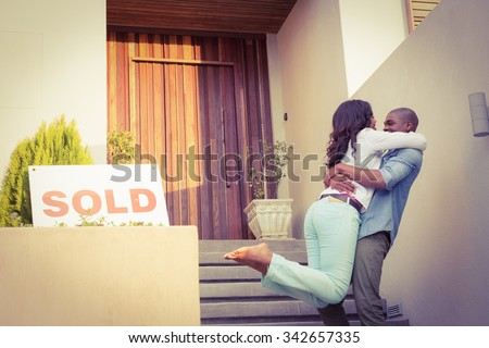 Portrait of happy couple after buying new house - stock photo