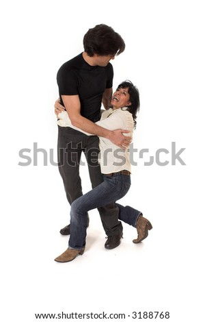 portrait of happy couple cuddling over white background