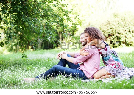 Portrait of happy couple embracing outdoor in park
