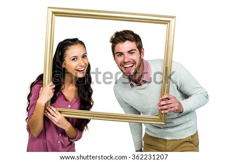 Portrait Happy Couple Holding Picture Frame Stock Photo (Royalty ...