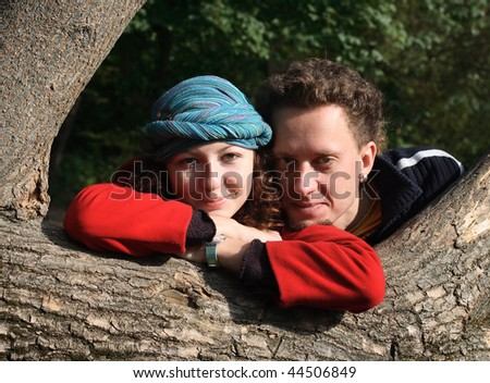 Portrait of happy couple in autumn clothes - stock photo