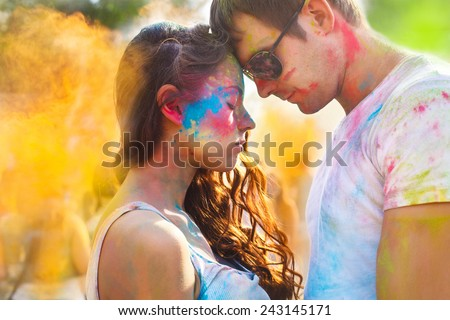 Portrait of happy couple in love on holi color festival - stock photo