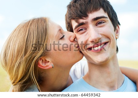 portrait of happy couple in love over blue sky - stock photo