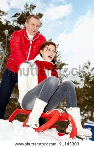 Portrait of happy couple in warm clothes having winter vacation