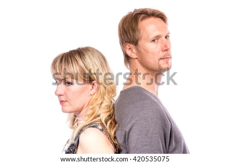 Portrait of happy couple isolated on white background.  Attractive man and woman being playful. Back to back.