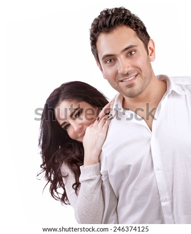 Portrait of happy couple isolated on white background, joyful woman looks over his shoulder men, romantic relationship, Valentine day, love and happiness concept  - stock photo