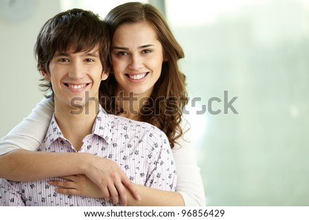 Portrait of happy couple looking at camera and smiling, copy space provided - stock photo