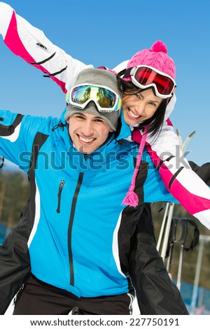 Portrait of happy couple of alps skiers have fun. Concept of winter sports and cute vacations - stock photo