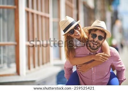 Portrait of happy couple outdoors - stock photo