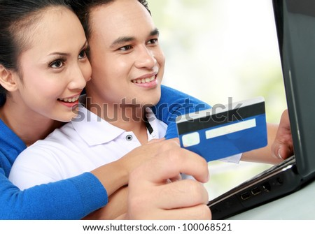 portrait of happy couple shopping online at house - stock photo