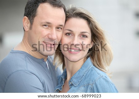 Portrait of happy couple standing outdoors
