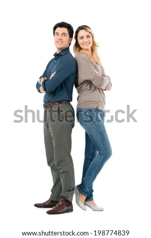 Portrait Of Happy Couple Standing With Arm Crossed Looking At Camera Isolated On White Background - stock photo