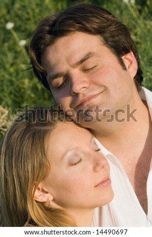 Portrait of happy couple with closed eyes