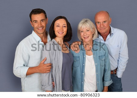 Portrait of happy couple with parents
