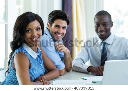 Portrait of happy couple with real estate agent at home - stock photo