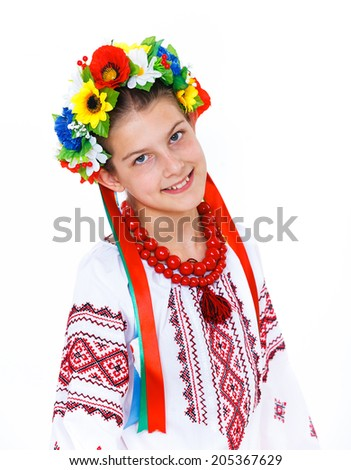 Portrait of happy cute girl in the Ukrainian national costume. Isolated white background