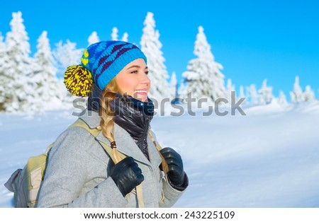 Portrait of happy cute girl traveling along snowy mountains, enjoying wintertime nature, active lifestyle, winter vacation concept - stock photo