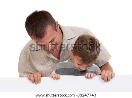 Portrait of happy dad and son with empty white board isolated on white background - stock photo