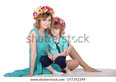 Portrait of happy daughter and her mother, isolated over white - stock photo