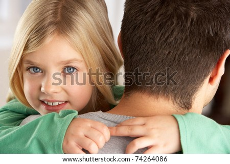 Portrait Of Happy Daughter Looking Over Fathers Shoulder - stock photo