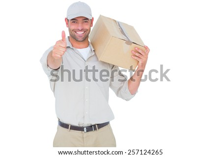 Portrait of happy delivery man with cardboard box gesturing thumbs up on white background - stock photo