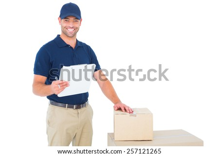 Portrait of happy delivery man with cardboard boxes and clipboard on white background - stock photo