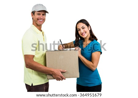 Portrait of happy delivery man with customer against white background - stock photo