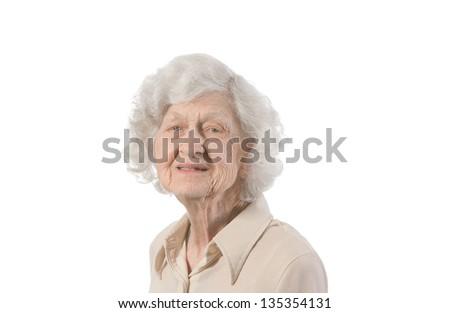 Portrait of happy elder lady. shot against white background. - stock photo