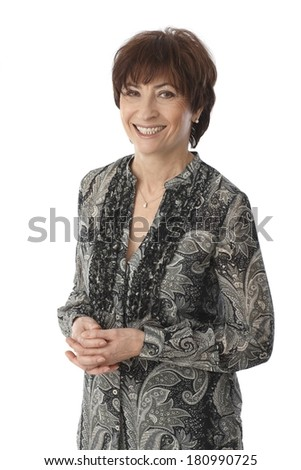 Portrait of happy elderly woman, smiling, looking at camera. - stock photo