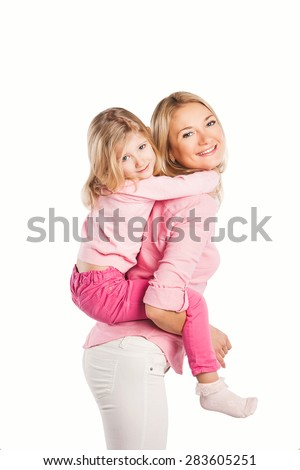 Portrait of happy embracing mother and daughter. family, children and happy people concept  - stock photo