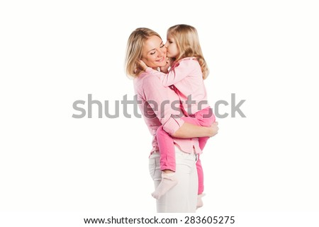 Portrait of happy embracing young mother and little daughter isolated on white - stock photo