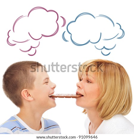 Portrait of happy european family of son and his mother eating chocolate bar together isolated on white background. Blank Cloud balloon overhead - stock photo