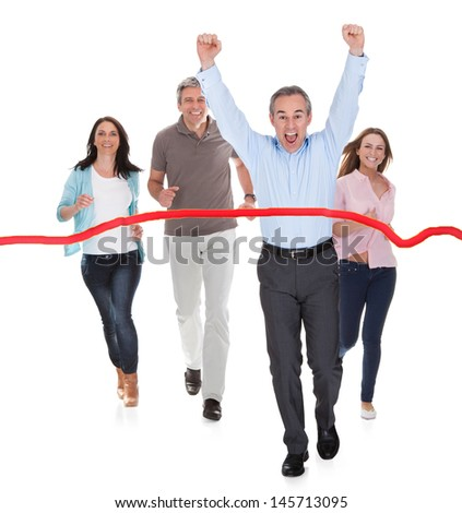 Portrait Of Happy Excited Businessman Wins The Race - stock photo