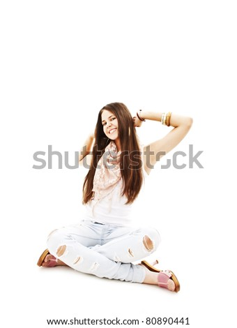 Portrait of happy excited girl with arms extended. Over white background - stock photo
