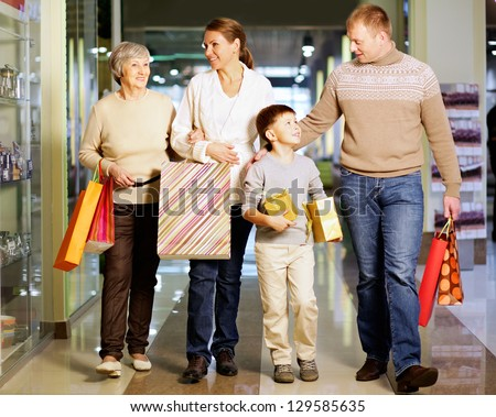 Portrait of happy family during shopping in the mall - stock photo