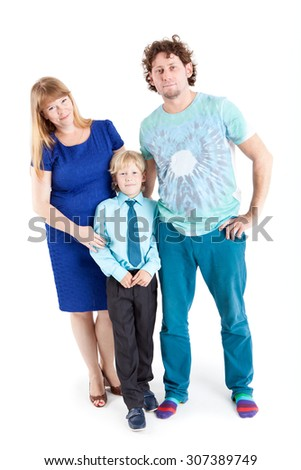 Portrait of happy family embracing and looking at camera, isolated on white background - stock photo