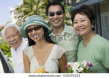 Portrait of happy family enjoying summer vacations - stock photo