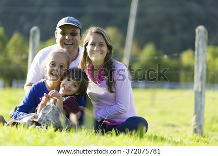 Portrait of Happy Family, Father, Mother And Their Children Having Fun Outdoors - stock photo