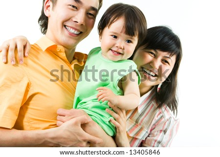 Portrait of happy family:  father, mother and their daughter - stock photo