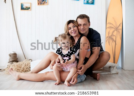 Portrait of happy family: father, mother, daughter - stock photo