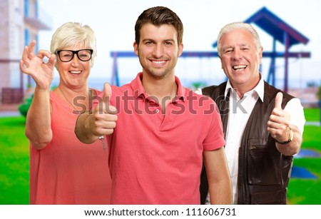 Portrait Of Happy Family Gesturing Together - stock photo
