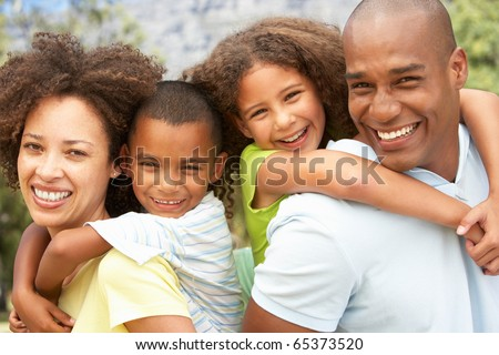 Portrait of Happy Family In Park - stock photo