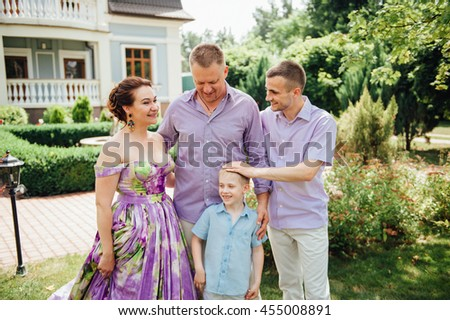 Portrait of Happy Family In Park - outdoor shot. - stock photo