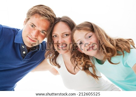 Portrait of happy family isolated over white background - stock photo