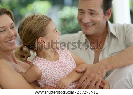 Portrait of happy family laughing together - stock photo