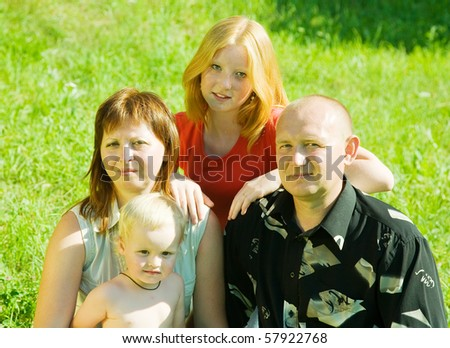 portrait of  happy family of four against nature - stock photo
