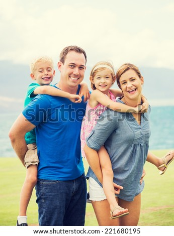 Portrait of Happy Family of Four Outside - stock photo